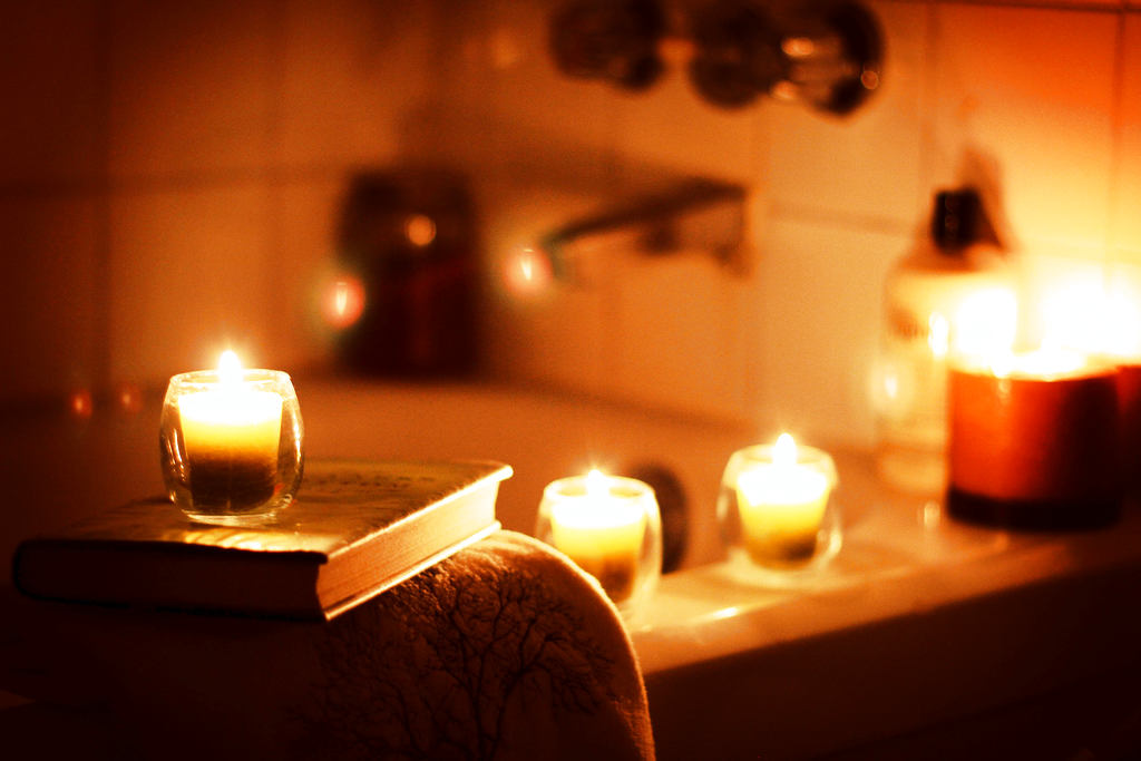 romantic bathtub with low light and candles